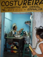 This seamstress in Rocinha had clothing repairs stacked to the ceiling just inside her shop door.