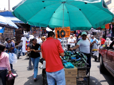 "The orange sign claims of the spray deodorant on sale at El Tepito: ""It's stolen, but not used."" (Credit: J. Renteria)"