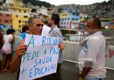 Another good use of Niemeyer architecture: Protestors demonstrate at Rocinha's Passarela on Tuesday.