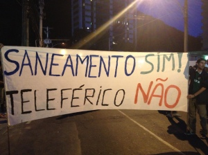 A banner calls for more sanitation projects and no gondola. Photo by author