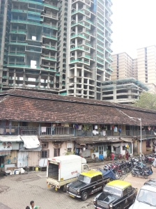 One Avighna Park, rising above an old chawl building, Lalbaug, Parel, Mumbai