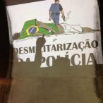 Here we see the same political cartoon by Latuf memorializing Douglas Rodrigues, this time accompanied with the demand to demilitarize the police force. The image was projected onto the Arcos da Lapa in Rio de Janeiro during a recent protest. [photo by Colectivo Projetação]