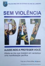 """This is pamphlet promoting a peaceful demonstration was handed out by UPP officers (the favela-specific """"Pacifying Police Unit"""") at the first protest march organized by Rocinha residents. It reads """"Without Violence. Peace. Help us protect you; stay away from those who insist on vandalizing a peaceful protest."""" This was the only instance I saw the pamphlet and it was the only protest in which I saw police officers engaging 'peacefully' with protestors before the march began (although in São Paulo they have designated a special officer to act as negotiator between protestors and the police). The chant SEM VIOLENCIA was often heard during the first month of protests. Eventually more radical factions within a given march would chant back """"SEM MORALISMO"""" (without moralism). When no police are present, one often hears the Black Bloc chant, """"what a coincidence; when there's no police, there's no violence."""""""
