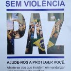 "This is pamphlet promoting a peaceful demonstration was handed out by UPP officers (the favela-specific ""Pacifying Police Unit"") at the first protest march organized by Rocinha residents. It reads ""Without Violence. Peace. Help us protect you; stay away from those who insist on vandalizing a peaceful protest."" This was the only instance I saw the pamphlet and it was the only protest in which I saw police officers engaging 'peacefully' with protestors before the march began (although in São Paulo they have designated a special officer to act as negotiator between protestors and the police). The chant SEM VIOLENCIA was often heard during the first month of protests. Eventually more radical factions within a given march would chant back ""SEM MORALISMO"" (without moralism). When no police are present, one often hears the Black Bloc chant, ""what a coincidence; when there's no police, there's no violence."""