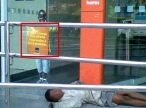 """One of the biggest polemics surrounding the protests is the routine attacks against bank branches by radical groups, and the defence of such tactics by anarchist activists online (commonly on the Black Bloc facebook page). Here we see a child, presumably homeless, sleeping outside the entrance of Itaú Bank. Whoever posted the photo to facebook (I grabbed it off of the Black Bloc facebook page) drew a red box around a sign that reads, """"All children have the right to learn to read and write,"""" highlighting the ironic similarity between the boy in the marketing propaganda and the boy sleeping on the pavement. This image is a type of counter discourse used to critique the social system that allows Brazil's economy to boom and banks to post windfall profits, but children are continually denied basic human rights (to housing, to education, to food). Tarnishing Itau's public image in the recent past is a greater than RS$ 18 billion (more than US$7.7 billion) fine for failing to pay taxes. [photo unaccredited on facebook; I have blurred the child's face to protect his identity]"""