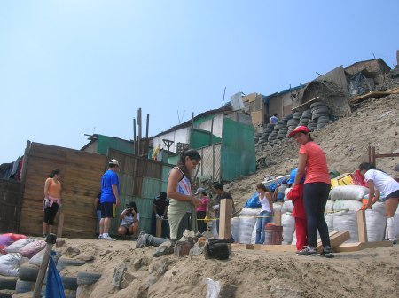 "Figure  5 on site construction of a ""media agua"" at Ventanilla, Peru. Credits: Image of Tal Sustiel"