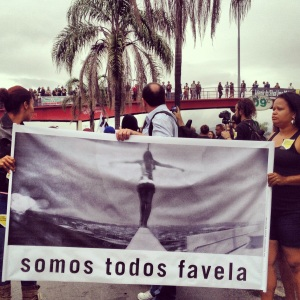 "This banner reads ""We are all favela"" as a slogan of unity in a divided city."