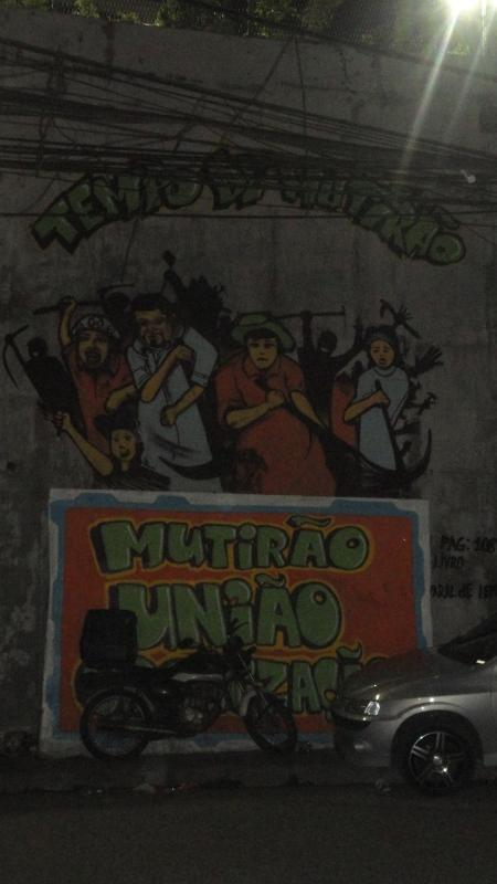 """Street art depicting the importance of Mutirão: """"Tempo de Mutirão: Mutirão, União, Organização."""" Curva do S, Rocinha"""