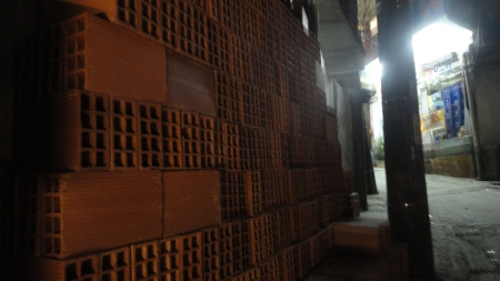 Bricks ready to go in Rua Umhe continual nature of autoconstrucão in Rua 4, Rocinha, Rio de Janeiro.