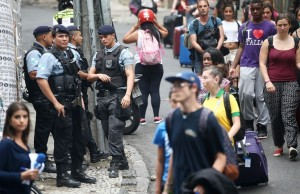 Police at the entrance of favela Pavão-Pavãozinho. (Click through for story and credit).