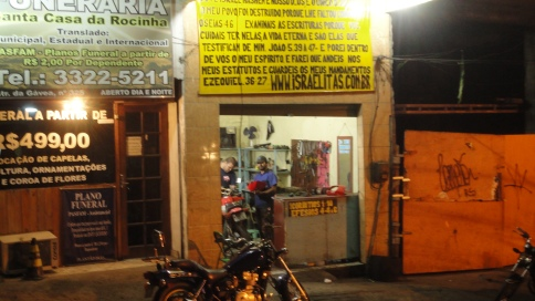 Motorcycle Shop still open for business, at 10 pm.