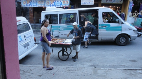 A vendor of sweets takes her cart along the steeop streets and becos of Rocinha, Rio de Janeiro.