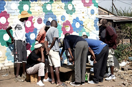 Soweto, South Africa (gang gambling ring playing street craps)