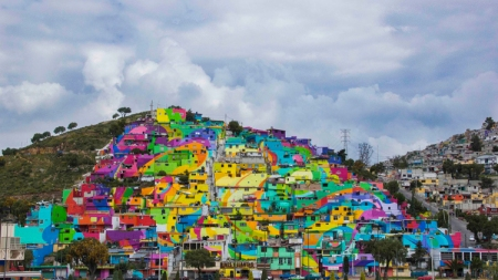 germen-crew-turns-mexican-village-into-a-rainbow-mural-2.jpg
