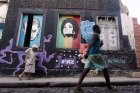 People walk past graffiti art in the Providencia community of Rio, a favela that dates back to 1897. Mario Tama/Getty Images