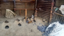 Common kitchen with shared stoves, fueled by textile waste; photo credit: Lubaina Rangwala