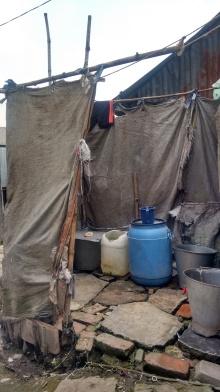 Community built, shared bathing facility; photo credit: Lubaina Rangwala