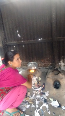 Starting a fire to cook. Women remain most exposed to respiratory illnesses; Photo credit: Lubaina Rangwala